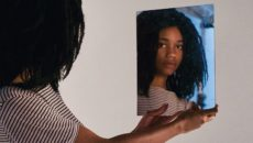 A preteen looks in the mirror as she wrestles with identity struggles