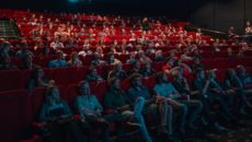Adoption in the movies: a group of people at a theater