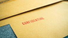 "A file stamped, ""Confidential"" represents closed adoption records."