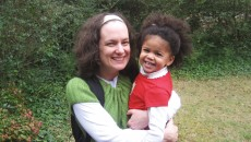 Patti Ghezzi and her daughter, a black baby with natural hair