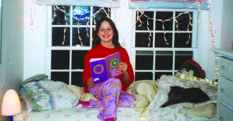 Alexandra, happily overcoming her reading disability