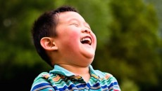 A laughing child who joined his family through Taiwan adoption