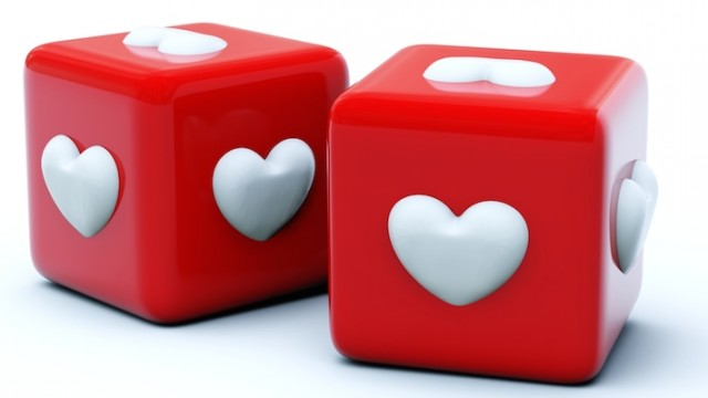 Red dice with hearts for playing Bunko, this author's adoption support group