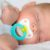 Infant baby boy sleeping peacefully with pacifier