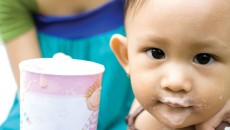 One parent supplements her child's diet after adopting a malnourished child.