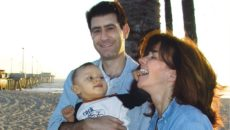 I.D. Steinberg and her husband pose with the son that made them first time parents
