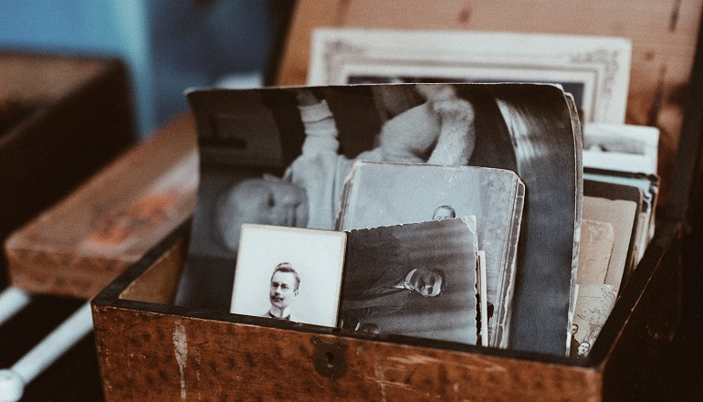 A box of old photographs that show family resemblance