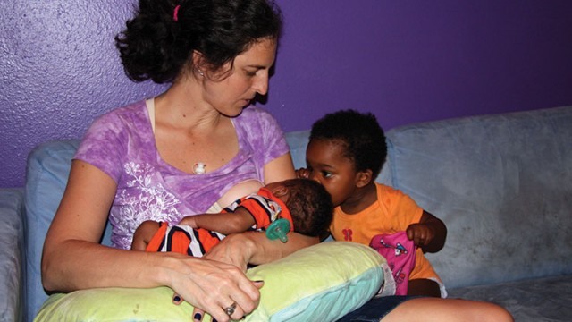 A woman with her children after adoptive breastfeeding.
