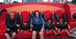 A family at a theme park for their summer adoption plans