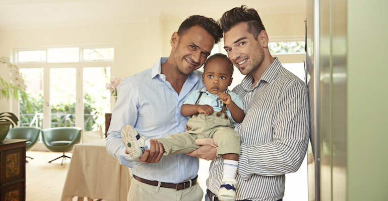 Parents like this happy gay couple talk about becoming a mom or dad after adoption