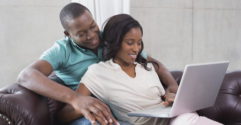 An African-American couple on the computer creating an adoption profile