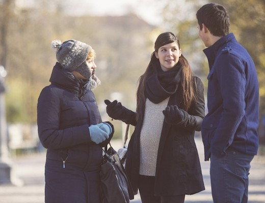 A couple meeting with a pregnant woman, hoping to have a positive expectant mother match