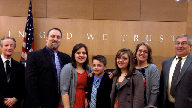 A family in court on their 10-year-old son's adoption day from foster care.
