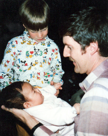 Emily Greene Thornton as an infant on her adoption day, with her adoptive father and brother