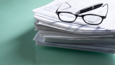 stack of forms you might need to claim the adoption tax credit