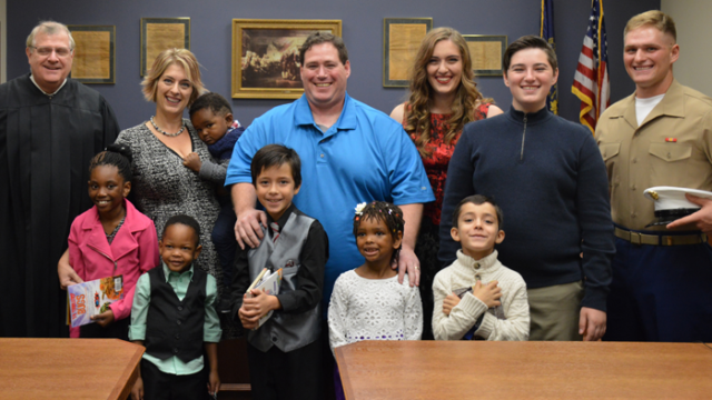 Julia Baxter with her family, including four new siblings through foster adoption, on their adoption day