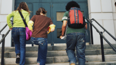 a transracially adopted teen heading into school with friends
