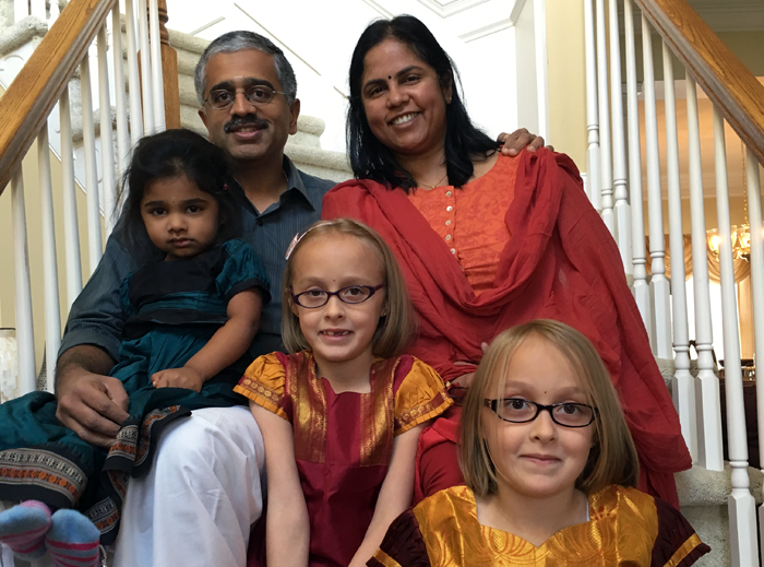 author Lakshmi Iyer with her family, including twins adopted as older infants in an open adoption