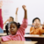 diverse adopted children raising their hands in a classroom, feeling safe at school