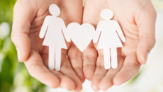 adoption-news-aclu-sues-michigan-bias-against-same-sex-parents-hands-paper-cutout
