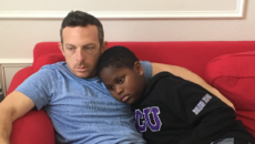 author Billy Cuchens and his son Jayden snuggle together at home