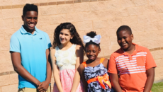 Four of author Billy Cuchens's children through transracial adoption